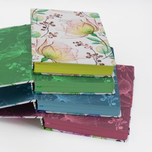 Image shows a stack of 4 different MOM Diaries
