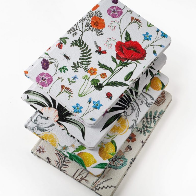 Image shows all four floral hardcover journals