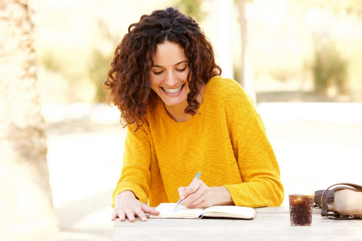 Lady writing in diary