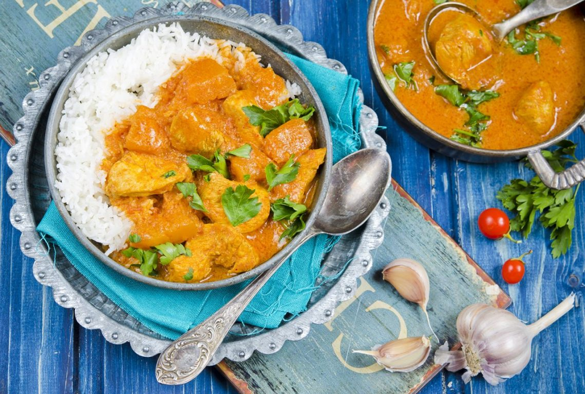 Image shows thai chicken curry with butternut