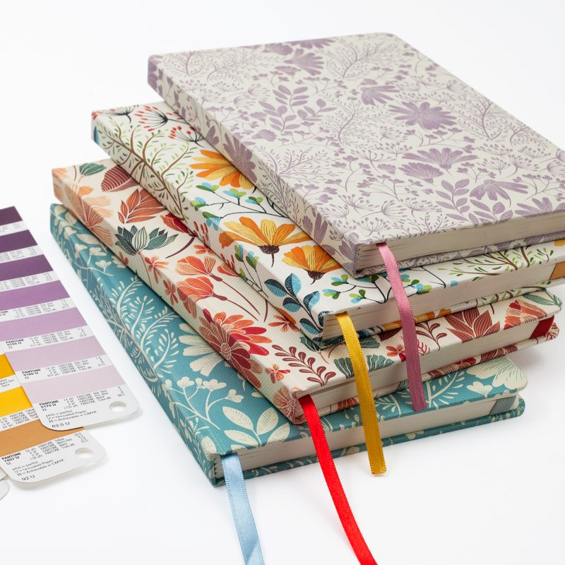 Image shows stack of Floral Premium Dot Journals
